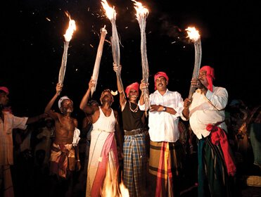 Ahikuntika People are holding Traditional Torches