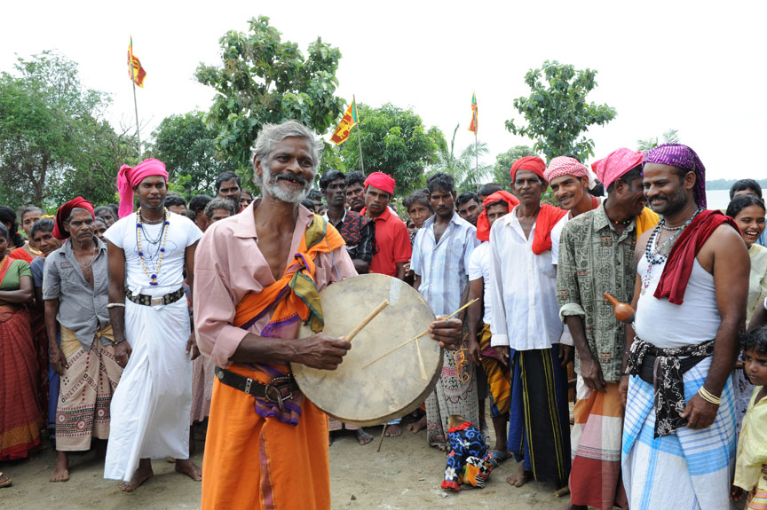 Man from Ahikuntaka playing the Hand Drum