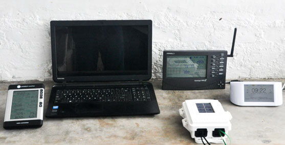 A Laptop with Equipment to Check Climate